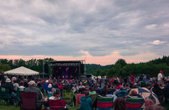 Crowds enjoying music concert with lovely sunset Royalty Free Stock Image