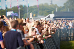 Crowds Enjoying Themselves At Outdoor Music Festival. In The Sun Having Fun stock image