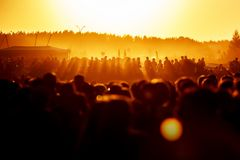 Crowds Enjoying Themselves At Outdoor Music Festival. Sunset stock image