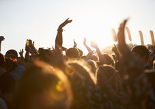 Crowds Enjoying Themselves At Outdoor Music Festival. Waving Hands In The Air royalty free stock images