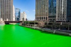 Crowds gather to celebrate St. Patrick`s Day in Chicago. Overlooking a dyed-green Chicago River royalty free stock images