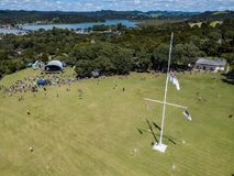 Aerial, Waitangi Day At Treaty Grounds. Crowds gather at waitangi treaty grounds in the bay of islands, aerial view of flag pole Stock Images