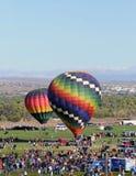 Crowds at hot air balloon festival Stock Photos
