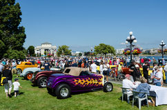 Crowds inspect classic cars at Northwest Deuce Days. Crowds inspect classic cars at the waterfront in the provincial capital of British Columbia during Northwest Royalty Free Stock Photo