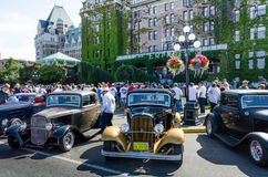 Crowds inspect vintage cars during Northwest Deuce Days. Crowds inspect 1932 Ford Deuce Coupes parked in front of the Empress Hotel during Northwest Deuce Days Stock Photo