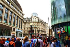 Busy Leicester Square London England United Kingdom. Crowds on Leicester Square with nice old and modern buildings City of Westminster London England United royalty free stock image