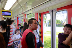 Crowds in light rail train compartment Stock Image