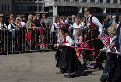 Crowds lining the street for the children`s parade on Norway`s National Day, 17th of May Stock Photos