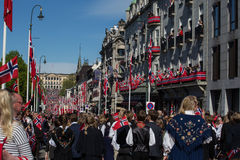 Crowds lining the street for the children`s parade on Norway`s National Day 17th of May. Oslo, Norway - May 17, 2016: Crowds lining the street for the children`s Stock Images