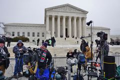 Crowds of mourners and media in front of the Supreme Court building where late Justice Antonin Scalia lays in repose Royalty Free Stock Images