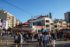 Crowds move through Taksim Square Stock Photo