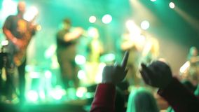 Crowds at open air rock festival. Close up of hands moving in the rhytm of music stock video