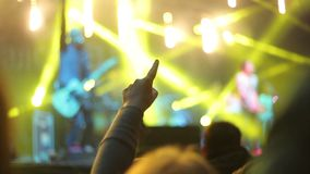Crowds at open air rock festival. Detailed view of hand cheering to band playing at rock festival stock video