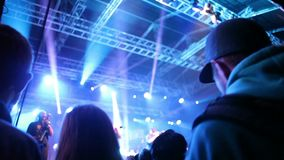 Crowds at open air rock festival. People dancing at local open air rock festival stock video footage