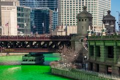 Crowds of partiers gather to see a dyed green Chicago River and celebrate. St. Patrick`s Day stock photos