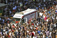 Crowds of people and ambulance Royalty Free Stock Image