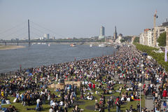 Crowds of people on the bank of Rhein. Dusseldorf, Germany - May 17, 2014: Crowds of people on the bank of Rhein, celebrating the Day of Japan in Dusseldorf on Stock Images