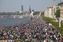 Crowds of people on the bank of Rhein. Dusseldorf, Germany - May 17, 2014: Crowds of people on the bank of Rhein, celebrating the Day of Japan in Dusseldorf on Royalty Free Stock Images