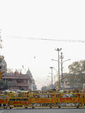 Crowds of People behind Police Barricade Delhi India. Crowds of people are held at bay by yellow police barriers on the streets of the city of Delhi in India Royalty Free Stock Photography