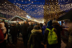 Crowds of people on Christmas fair at Kiev. Kiev, Ukraine - December 27, 2015: Crowds of people on Christmas fair on Sophia Square at main Kiev`s New Year tree Royalty Free Stock Images