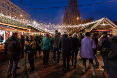 Crowds of people on Christmas fair at Kiev. Kiev, Ukraine - December 27, 2015: Crowds of people on Christmas fair on Sophia Square at main Kiev`s New Year tree Royalty Free Stock Photo