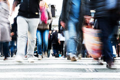Crowds of people crossing a city street Royalty Free Stock Photo