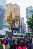 Crowds of people crossing King`s Road in Hong Kong Stock Photography