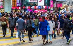 Crowds of people crossing King`s Road in Hong Kong Royalty Free Stock Image