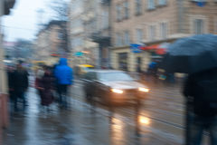 Crowds of people crossing street on rainy day in the city Royalty Free Stock Images