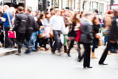 Crowds of people crossing the street. Shown with long exposure in motion blur Royalty Free Stock Photo