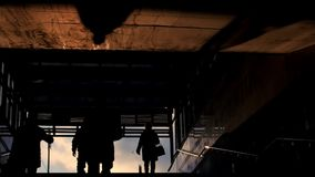 Crowds of people down in subway at winter sunset, silhouette. Wide angle stock video footage