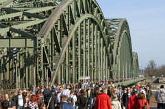 Crowds of people on Hohenzollern Bridge, Cologne Royalty Free Stock Photos