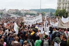 Crowds of people holding banners protesting again local ministry on a square stock photography