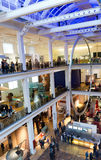 Crowds of people looking at exhibits and displays Royalty Free Stock Image