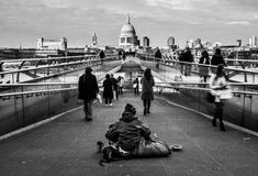 Crowds of people on Millennium Bridge, London