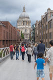 Crowds of people on Millennium Bridge, London royalty free stock photos