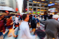 Crowds of people on the move on Broadway, Manhattan, New York City. Picture with camera made motion blur effect of crowds of people on the move on Broadway Royalty Free Stock Photos