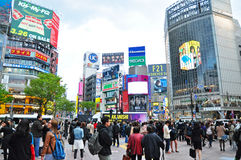 Crowds of people at Shibuya. TOKYO - APRIL 04: Crowds of people crossing the center of Shibuya on April 04, 2014. The most important commercial center in Tokyo Royalty Free Stock Photos