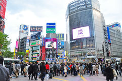 Crowds of people at Shibuya. TOKYO - APRIL 04: Crowds of people crossing the center of Shibuya on April 04, 2014. The most important commercial center in Tokyo Stock Images