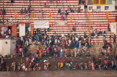 Crowds of people the stairs of the embankment of the river Ganges, Varanasi, India. VARANASI, INDIA. February 28, 2017: Crowds of people the stairs of the Stock Photography