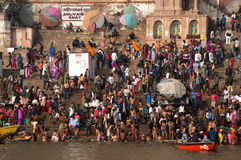 Crowds of people the stairs of the embankment of the river Ganges, Varanasi, India. VARANASI, INDIA. February 28, 2017: Crowds of people the stairs of the Royalty Free Stock Images