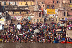 Crowds of people the stairs of the embankment of the river Ganges, Varanasi, India. VARANASI, INDIA. February 28, 2017: Crowds of people the stairs of the Stock Photo
