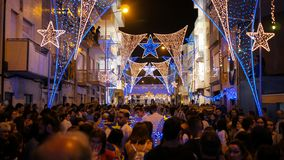 Crowds and street illuminations during Sao Pedro festival Povoa de Varzim, Portugal royalty free stock photo