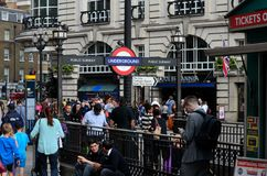 Crowds of people throng Piccadilly Circus Tube subway station London England. London, England - June 19, 2014: Crowds of men, women, children and families throng Stock Photography