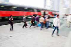 Crowds of people at the train station. Crowds of people walking at the train station in motion blur Stock Photos