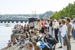 Crowds of People Watching Bideford Regatta. Bideford, Devon, UK - August 26, 2007: Crowds of people lined up along the river Torridge to watch regatta rowing Royalty Free Stock Photography