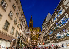 Crowds on Rue Merciere. Strasbourg, France - December 8, 2013 - Crowds walk up Rue Merciere to the Christmas Market by the Cathedral at night on December 8, 2013 Royalty Free Stock Image
