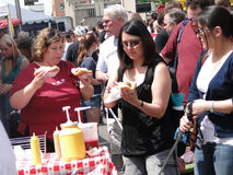 Crowds sample the food Stock Images