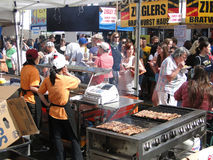 Crowds sample the food Royalty Free Stock Images