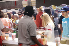 Crowds sample the food Royalty Free Stock Photo